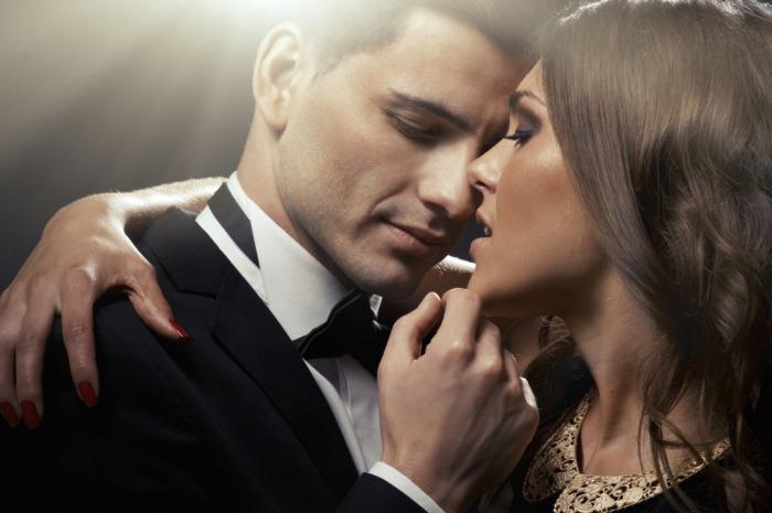 Sensual dark portrait of cute sexy young couple