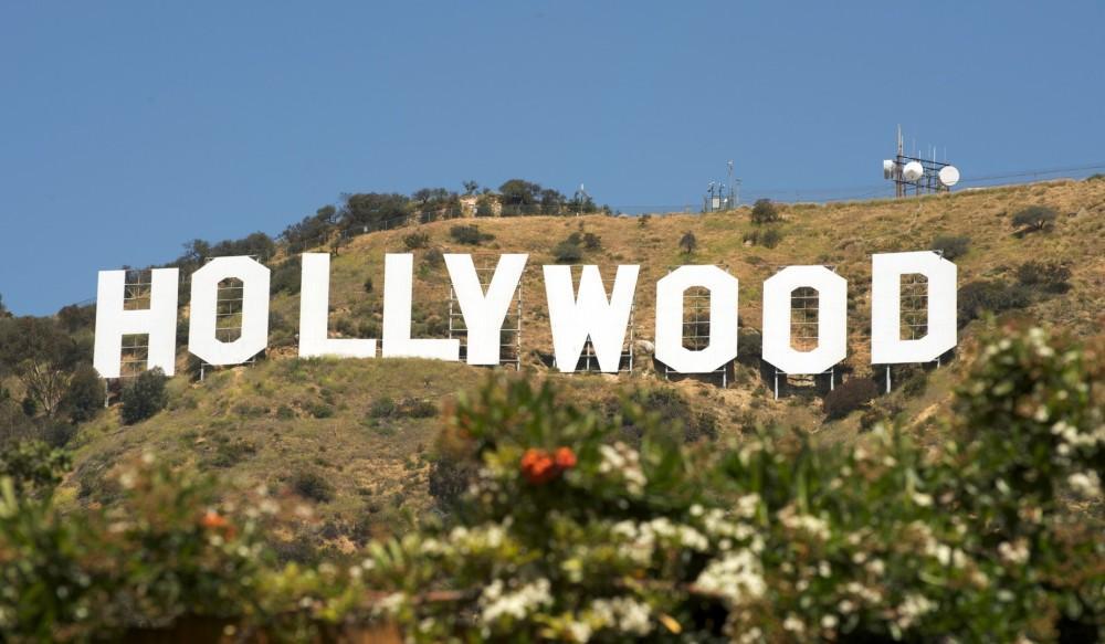 bigs-HOLLYWOOD-sign-with-flowers-in-foreground-Los-Angeles-CA-e1-Large
