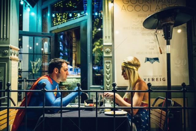 stock-photo-restaurant-dinner-patio-superman-dining-food-and-drink-dating-wonder-woman-wonderwoman-ebdc9404-a484-46f3-afe2-64681